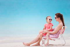 Mother and daughter at tropical beach Royalty Free Stock Photos