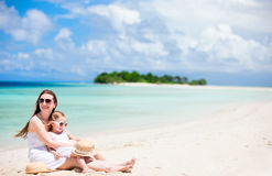 Mother and daughter at tropical beach Stock Photos