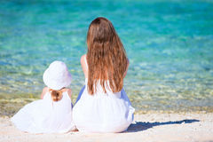 Mother and daughter on tropical beach Stock Images