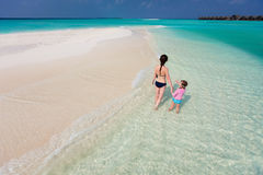 Mother and daughter at tropical beach Royalty Free Stock Photo