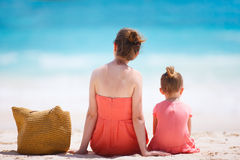Mother and daughter on tropical beach Royalty Free Stock Photo
