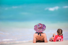 Mother and daughter on tropical beach Royalty Free Stock Photos