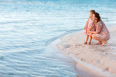 Mother and daughter at tropical beach Royalty Free Stock Images