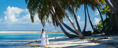 Mother and daughter on tropical beach Royalty Free Stock Images