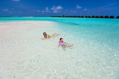 Mother and daughter at tropical beach Stock Images