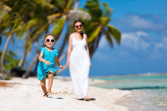 Mother and daughter on a tropical vacation Stock Photos