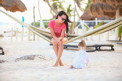 Mother and daughter on tropical vacation relaxing Royalty Free Stock Photos
