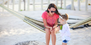 Mother and daughter on tropical vacation relaxing Royalty Free Stock Photo