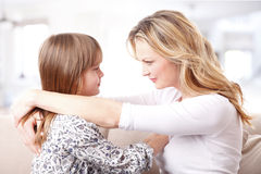 Mother and daughter trusting each other Stock Photos