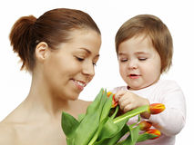 Mother and daughter with tulips Stock Photos
