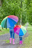 Mother and daughter with umbrellas Royalty Free Stock Photo