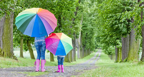Mother and daughter with umbrellas Royalty Free Stock Photos