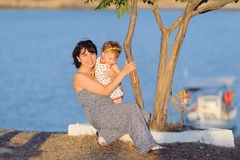 Mother and Daughter under Tree Stock Image