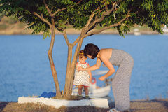 Mother and Daughter under Tree Royalty Free Stock Images