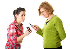 Mother and daughter uses their mobile phones Stock Image