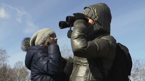Mother and daughter using binoculars at outdoor. Stock footage video stock video footage