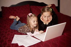 Mother and Daughter using computer Royalty Free Stock Images