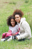 Mother And Daughter Using Digital Tablet Countryside royalty free stock photo