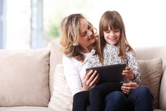 Mother and daughter using digital tablet Stock Image