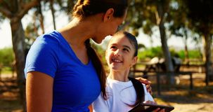 Mother and daughter using digital tablet 4k. Mother and daughter using digital tablet in ranch 4k stock footage