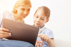 Mother and daughter using digital tablet Stock Photography
