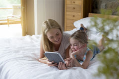 Mother and daughter using a digital tablet together Royalty Free Stock Image