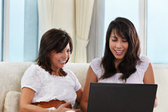 Mother and daughter using laptop Stock Photography