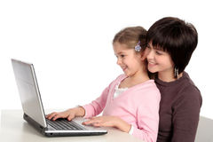 Mother and Daughter Using Laptop Royalty Free Stock Photos