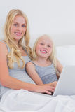 Mother and daughter using a laptop Stock Photo