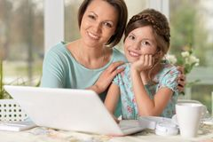 Mother and daughter using laptop Royalty Free Stock Image