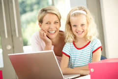 Mother And Daughter Using Laptop At Home Royalty Free Stock Images