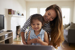 Mother And Daughter Using Laptop At Home Together Royalty Free Stock Photo