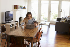 Mother And Daughter Using Laptop At Home Together Stock Images