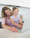Mother and daughter using laptop together Royalty Free Stock Photo