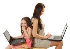 Mother and daughter using laptops Royalty Free Stock Photography