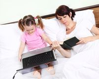 Mother and daughter using methods to learn Royalty Free Stock Photography