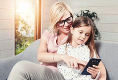 Mother And Daughter Using Mobile Phone royalty free stock photo