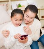 Mother and daughter using smart phone Royalty Free Stock Images