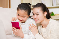 Mother and daughter using smart phone Royalty Free Stock Image
