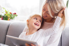 Mother and daughter using tablet computer together Royalty Free Stock Images