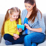 Mother and daughter using tablet PC Royalty Free Stock Photos