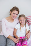 Mother and daughter using tablet pc Royalty Free Stock Image