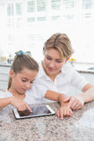 Mother and daughter using tablet pc Stock Photo