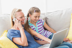 Mother and daughter using technologies at home Royalty Free Stock Image