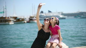 Mother and daughter on vacation photographed beside the Adriatic Sea in Croatia stock video