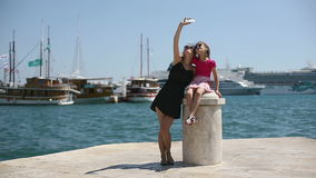 Mother and daughter on vacation photographed beside the Adriatic Sea in Croatia. In the port city of Split. Close up. Model Elizabeth Andreeeva stock video