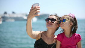 Mother and daughter on vacation photographed beside the Adriatic Sea in Croatia stock video footage