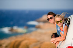 Mother and daughter on vacation travel by car. Summer holiday and car travel concept. Family travel. Royalty Free Stock Photos