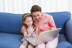 Mother and daughter video chatting with laptop Royalty Free Stock Photos