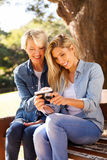 Mother daughter viewing pictures Stock Image